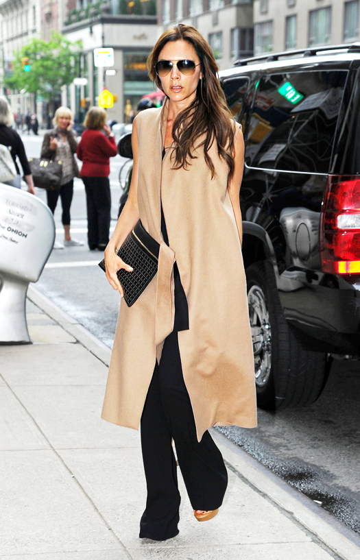 Victoria Beckham goes on a shopping spree in a sleevless beige cape to the Barneys New York on Madison Avenue then Prada Fifth Avenue, NYC. Pictured: Victoria Beckham Ref: SPL541298  110513   Picture by:  Splash News Splash News and Pictures Los Angeles:310-821-2666 New York:212-619-2666 London:870-934-2666 photodesk@splashnews.com