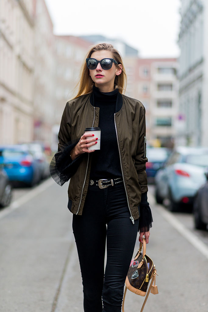 BERLIN, GERMANY - JANUARY 19: Kimyana Hachmann  wearing a top and bomber jacket Zara, H&M pants, Mango ankle boots, Louis Vuitton bag, Chanel sunglasses during the Mercedes-Benz Fashion Week Berlin A/W 2017 at Kaufhaus Jandorf on January 19, 2017 in Berlin, Germany. (Photo by Christian Vierig/Getty Images)
