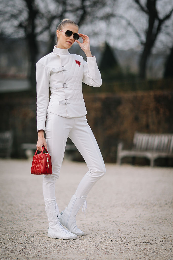 PARIS, FRANCE - JANUARY 23:  Lena Perminova wears a white jacket, sunglasses, white pants, white shoes, a red Dior bag, and attends the Christian Dior Haute Couture Spring Summer 2017 show as part of Paris Fashion Week, at the Rodin museum, on January 23, 2017 in Paris, France.  (Photo by Edward Berthelot/Getty Images)