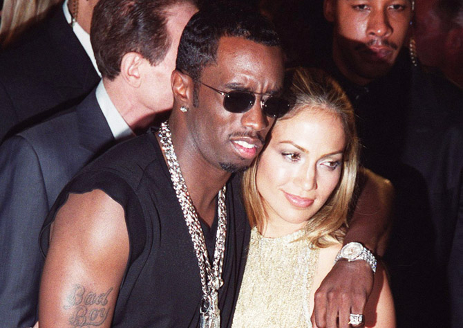"""NEW YORK, UNITED STATES:  This file photo shows rap artist Sean """"Puff Daddy"""" Combs (R) and singer/actress Jennifer Lopez (R) arriving for the MTV Video Music Awards at the Metropolitan Opera House at Lincoln Center in New York on 09 September, 1999. Combs and Lopez have been arrested in New York after a shooting incident at a nightclub that left three injured. Police are questioning the pair and charges have not been yet been filed.    AFP PHOTO/Henny Ray ABRAMS (Photo credit should read HENNY RAY ABRAMS/AFP/Getty Images)"""